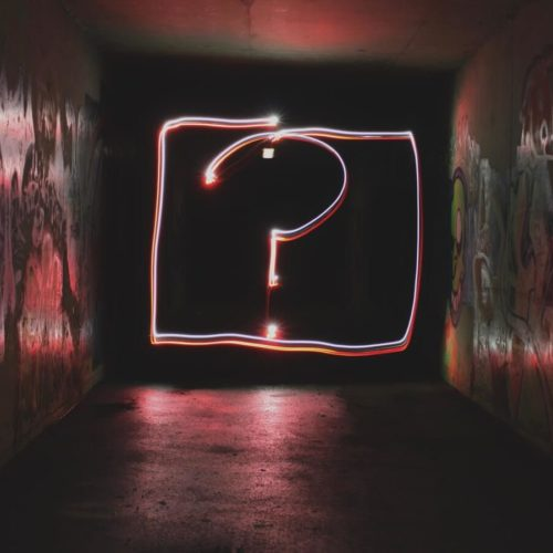 Common myths about cam girls - question mark neon sign